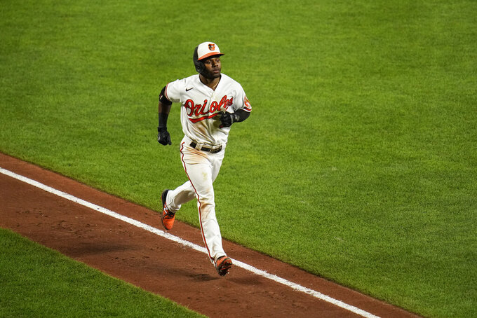 Baltimore Orioles' Cedric Mullins runs the bases after hitting a solo home run off Kansas City Royals relief pitcher Tyler Zuber during the seventh inning of a baseball game, Tuesday, Sept. 7, 2021, in Baltimore. (AP Photo/Julio Cortez)