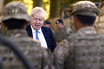 "Britain's Prime Minister Boris Johnson talks to Ghurkas as he meets with military personnel on Salisbury Plain training area near Salisbury, England, Thursday, Sept. 19, 2019. British Prime Minister Boris Johnson was accused by a one of the country's former leaders of a ""conspicuous"" failure to explain why he suspended Parliament for five weeks, as a landmark Brexit case at the U.K. Supreme Court came to a head on Thursday. (Ben Stansall/Pool Photo via AP)"