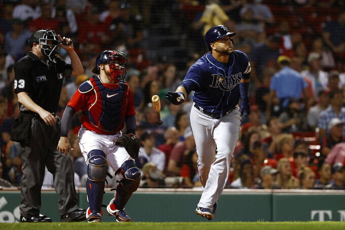 Tampa Bay Rays' Nelson Cruz tosses his bat as he watches his two-run home run during the third inning of the team's baseball game against the Boston Red Sox on Tuesday, Sept. 7, 2021, at Fenway Park in Boston. (AP Photo/Winslow Townson)