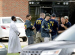 FILE - In this Aug. 15, 2017, file photo, law enforcement officials investigate the site of an explosion at the Dar Al-Farooq Islamic Center in Bloomington, Minn.The leader of an Illinois anti-government militia group who authorities say masterminded the 2017 bombing of a Minnesota mosque is to be sentenced Monday, Sept. 13, 2021, for several civil rights and hate crimes in an attack that terrified a community. (David Joles/Star Tribune via AP File)