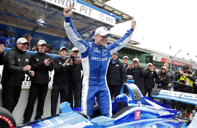 FILE - In this May 10, 2019, file photo, Felix Rosenqvist, of Sweden, celebrates after winning the pole during qualifications for the Indy GP IndyCar auto race at Indianapolis Motor Speedway in Indianapolis. Rosenqvist has been hired by Arrow McLaren SP for the 2021 IndyCar season. (AP Photo/Michael Conroy, File)