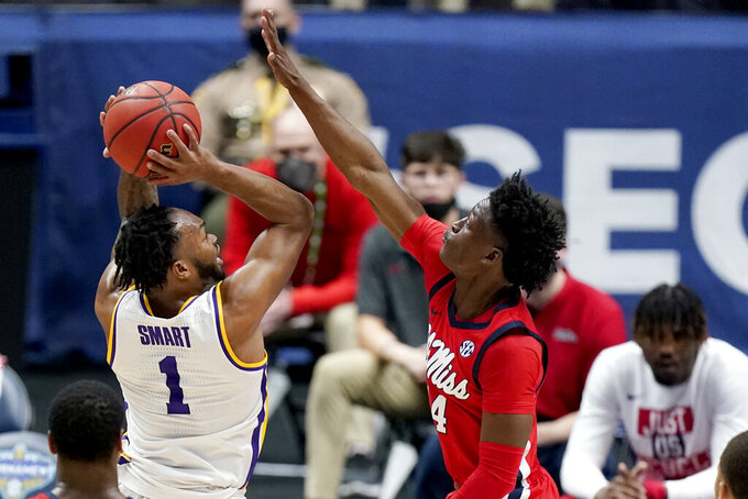 LSU's Ja'Vonte Smart (1) shoots against Mississippi's Jarkel Joiner (24) in the first half of an NCAA college basketball game in the Southeastern Conference Tournament Friday, March 12, 2021, in Nashville, Tenn. (AP Photo/Mark Humphrey)