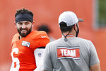 FILE - Cleveland Browns quarterback Baker Mayfield (6) talks with head coach Kevin Stefanski during practice at the NFL football team's training facility Monday, Aug. 24, 2020, in Berea, Ohio. It's all about the quarterbacks in the AFC North. (AP Photo/Ron Schwane, File)
