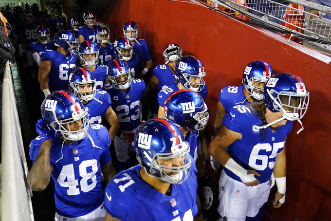 Members of the New York Giants wait in the tunnel to take the field before the start of first half of an NFL football game against the Washington Football Team, Thursday, Sept. 16, 2021, in Landover, Md. (AP Photo/Alex Brandon)