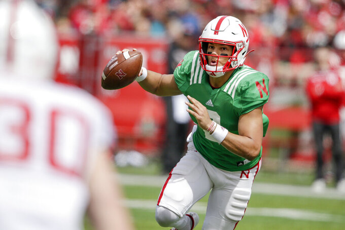 Nebraska red team quarterback Adrian Martinez (2) scrambles during Nebraska's NCAA college football annual red-white spring game, in Lincoln, Neb., Saturday, April 13, 2019. (AP Photo/Nati Harnik)