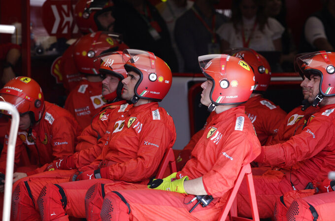 Ferrari mechanics at the pits during the Brazilian Formula One Grand Prix at the Interlagos race track in Sao Paulo, Brazil, Sunday, Nov. 17, 2019. (Amanda Perobelli/Pool Photo via AP)