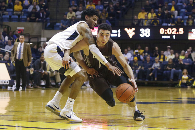 Lehigh guard Jordan Cohen (11) drives while defended by West Virginia guard James Bolden (3) during the first half of an NCAA college basketball game Sunday, Dec. 30, 2018, in Morgantown, W.Va. (AP Photo/Raymond Thompson)