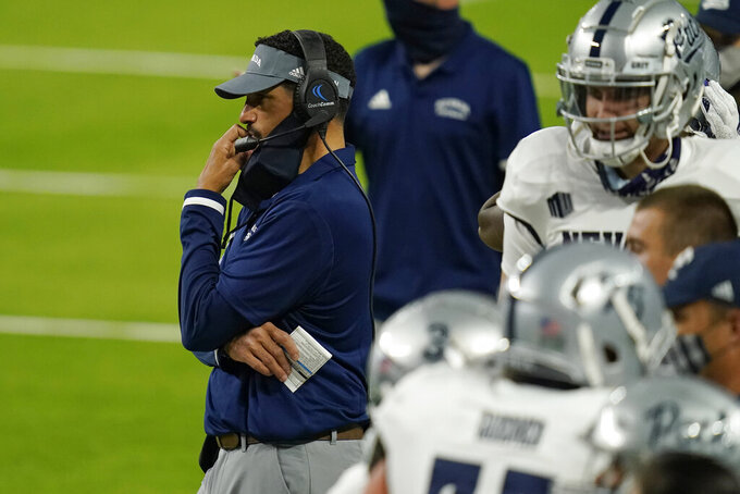 Nevada head coach Jay Norvell looks toward the field during the second half of an NCAA college football game against UNLV, Saturday, Oct. 31, 2020, in Las Vegas. (AP Photo/John Locher)