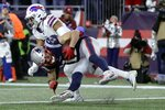 New England Patriots wide receiver Julian Edelman, front, catches a pass for a two-point conversion in the second half of an NFL football game against the Buffalo Bills, Saturday, Dec. 21, 2019, in Foxborough, Mass. (AP Photo/Steven Senne)