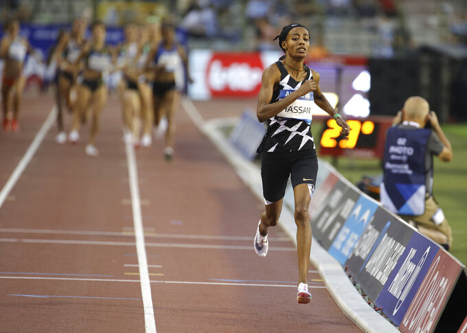 Netherland's Sifan Hassan competes in the 1 Mile Women during the Diamond League Memorial Van Damme athletics event at the King Baudouin stadium, Brussels, Friday, Sept. 3, 2021. (AP Photo/Olivier Matthys)