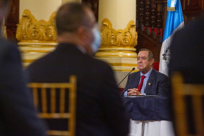 FILE - In this July 27, 2021 file photo, Guatemalan President Alejandro Giammattei attends a press conference at the National Palace in Guatemala City. Guatemala's Attorney General has opened an investigation into allegations that Giammattei received bribes from Russian businessmen, the prosecutor's office said on Friday, Sept. 3, 2021. (AP Photo/Oliver de Ros, File)