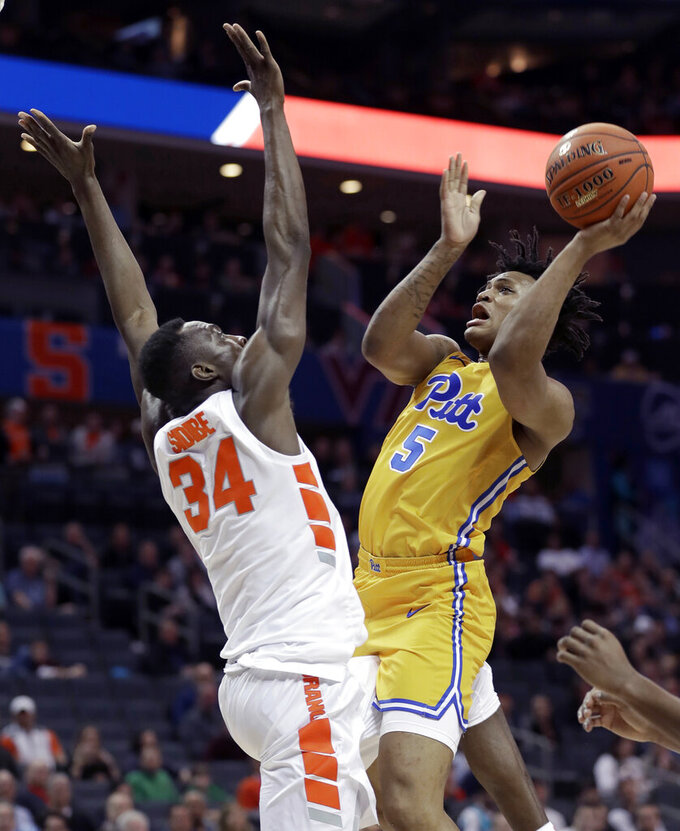 Pittsburgh's Au'Diese Toney (5) shoots over Syracuse's Bourama Sidibe (34) during the first half of an NCAA college basketball game in the Atlantic Coast Conference tournament in Charlotte, N.C., Wednesday, March 13, 2019. (AP Photo/Nell Redmond)