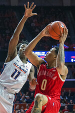 Nebraska's guard James Palmer Jr. (0) is guarded by Illinois guard Ayo Dosunmu (11) during the first half of an NCAA college basketball game in Champaign, Ill., Saturday. Feb. 2, 2019. (AP Photo/Robin Scholz)
