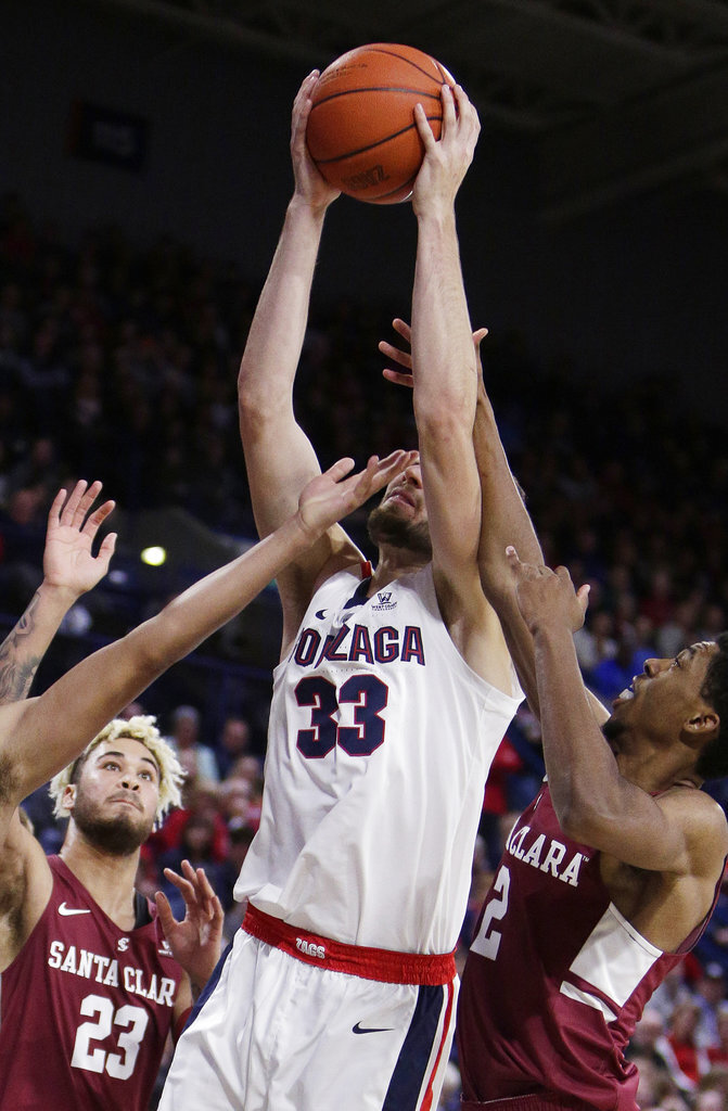 Gonzaga forward Killian Tillie (33) goes after a rebound against Santa Clara center Zeke Richards (23) and guard Tahj Eaddy (2) during the second half of an NCAA college basketball game in Spokane, Wash., Saturday, Jan. 5, 2019.(AP Photo/Young Kwak)