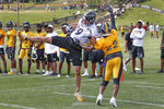 Pittsburgh Steelers tight end Vance McDonald (89) makes a catch in the end zone as Pittsburgh Steelers cornerback Steven Nelson (22) defends in a goal line drill during an NFL football training camp practice in Latrobe, Pa., Friday, July 26, 2019. (AP Photo/Keith Srakocic)