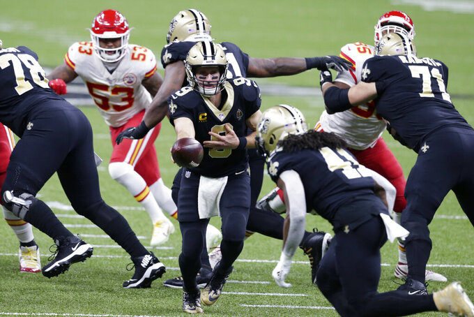 CORRECTS DATE New Orleans Saints quarterback Drew Brees (9) hands off to running back Alvin Kamara (41) in the first half of an NFL football game against the Kansas City Chiefs in New Orleans, Sunday, Dec. 20, 2020. (AP Photo/Butch Dill)
