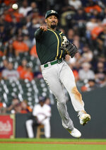 Oakland Athletics shortstop Marcus Semien throws out Houston Astros' George Springer during the seventh inning of a baseball game Wednesday, Sept. 11, 2019, in Houston. (AP Photo/Eric Christian Smith)
