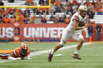 Boston College's Dennis Grosel, right, breaks away from Syracuse's Alton Robinson, left, during the first quarter of an NCAA college football game in Syracuse, N.Y., Saturday, Nov. 2, 2019. (AP Photo/Nick Lisi)