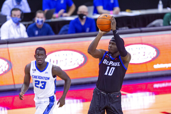 DePaul guard Ray Salnave (10) makes a three point shot against Creighton in the first half during an NCAA college basketball game Wednesday, Feb. 24, 2021, in Omaha, Neb. (AP Photo/John Peterson)