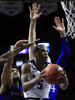 Kansas State guard Barry Brown Jr. (5) gets past Kansas forwards Dedric Lawson and Mitch Lightfoot (44) during the second half of an NCAA college basketball game in Manhattan, Kan., Tuesday, Feb. 5, 2019. (AP Photo/Orlin Wagner)