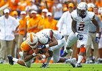 Tennessee quarterback Jarrett Guarantano (2) is hit by UTEP defensive back Nik Needham (5) in the first half of an NCAA college football game Saturday, Sept. 15, 2018, in Knoxville, Tenn. (AP Photo/Wade Payne)