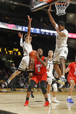 SMU guard Tyson Jolly (0) is blocked by Vanderbilt guard Scotty Pippen Jr. (2) and guard Jordan Wright (4) during the first half of an NCAA college basketball game Saturday, Jan. 4, 2020, in Nashville, Tenn. (AP Photo/Mark Humphrey)