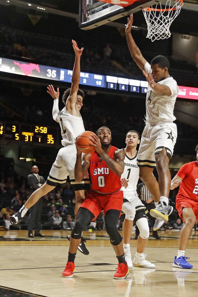SMU guard Tyson Jolly (0) is blocked by Vanderbilt guard Scotty Pippen Jr. (2) and guard Jordan Wright (4) during the first half of an NCAA college basketball game Saturday, Jan. 4, 2020, in Nashville, Tenn. (AP Photo/Mark Humphrey)