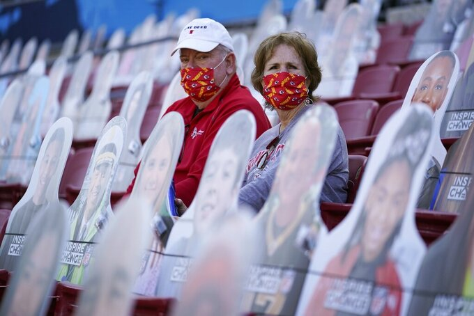 Fans wait for the start of NFL Super Bowl 55 football game between the Kansas City Chiefs and Tampa Bay Buccaneers, Sunday, Feb. 7, 2021, in Tampa, Fla. (AP Photo/Ashley Landis)