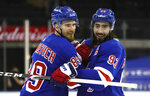 New York Rangers' Pavel Buchnevich (89) and Mika Zibanejad (93) celebrate their victory over the Buffalo Sabres in an NHL hockey game Monday, March 22, 2021, in New York. (Bruce Bennett/Pool Photo via AP)