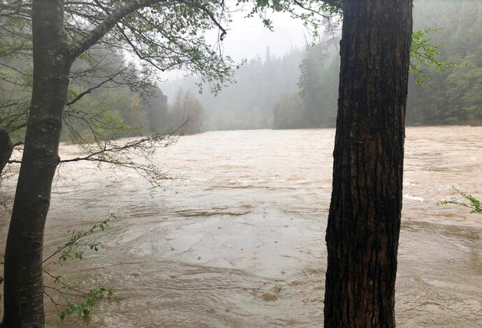 File - This photo released April 12, 2018, by The Mendocino County Sheriff's Office shows the Eel River in Northern California. Authorities searching for a family whose SUV plunged into a rain-swollen Northern California river found the vehicle and the body of a man and a girl inside it. The Mendocino County Sheriff's Office said Monday, April 16, 2018, that searchers located the car Sunday and recovered the bodies of Sandeep Thottapilly and Saachi Thottapilly. (Lt. Shannon Barney/Mendocino County Sheriff's Office via AP, File)