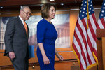 Speaker of the House Nancy Pelosi, D-Calif., and Senate Minority Leader Chuck Schumer, D-N.Y., left, and other congressional leaders, arrive to tell reporters about their failed meeting with President Donald Trump at the White House on infrastructure, at the Capitol in Washington, Wednesday, May 22, 2019.  (AP Photo/J. Scott Applewhite)