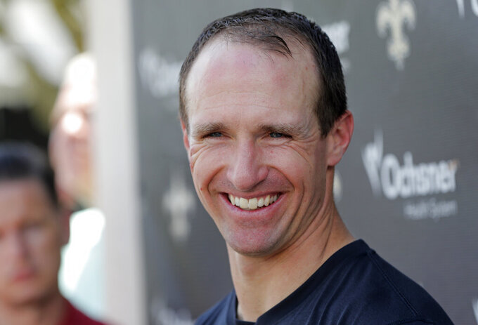New Orleans Saints quarterback Drew Brees talks to reporters after NFL football practice in Metairie, La., Thursday, May 23, 2019. (AP Photo/Gerald Herbert)