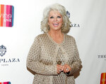 FILE - In this Feb. 13, 2015 file photo, TV personality Paula Deen attends the EVINE Live launch event in New York. Two of Paula Deen's Family Kitchen locations have closed in the Florida Panhandle. Paula Deen Ventures spokesman Jaret Keller confirmed Tuesday, Nov. 12, 2019, that licensing partner Phoenix Hospitality has decided to close its Destin and Panama City Beach restaurants. (Photo by Andy Kropa/Invision/AP, File)