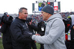FILE - In this Nov. 19, 2016, file photo, Ohio State coach Urban Meyer, left, and Michigan State coach Mark Dantonio shake hands after the Spartans won 17-16 in NCAA college football game in East Lansing, Mich. Ohio State visits Michigan State needing a win to stay on track for a Big Ten East showdown with Michigan in two weeks. (AP Photo/Al Goldis, File)
