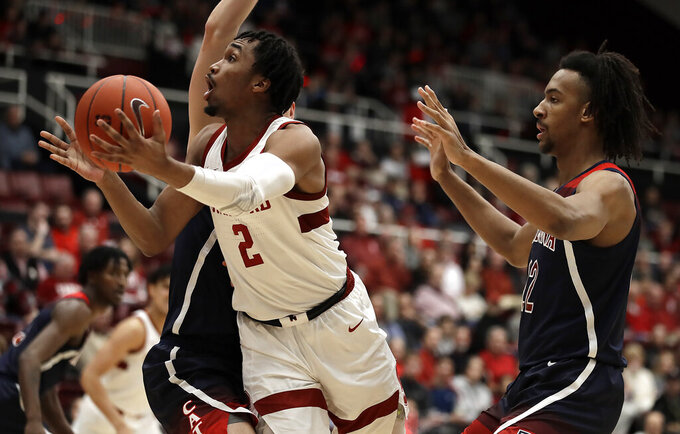 Stanford's Bryce Wills (2) shoots past Arizona's Zeke Nnaji during the first half of an NCAA college basketball game Saturday, Feb. 15, 2020, in Stanford, Calif. (AP Photo/Ben Margot)