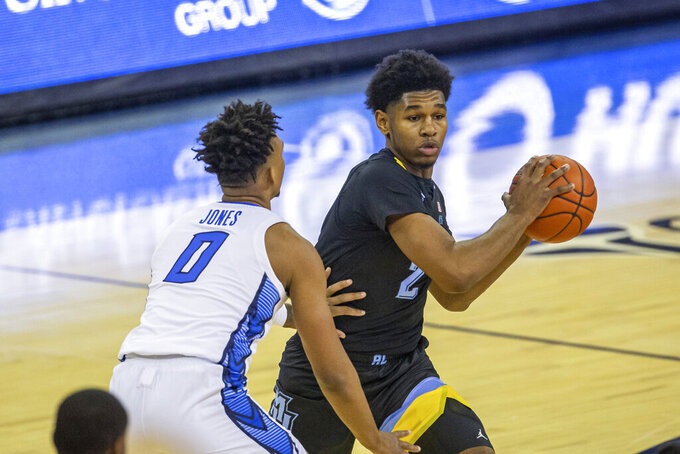 Marquette forward Justin Lewis (2) ready to pass against Creighton guard Antwann Jones (0) in the first half during an NCAA basketball game on Monday, Dec. 14, 2020, in Omaha, Neb. (AP Photo/John Peterson)