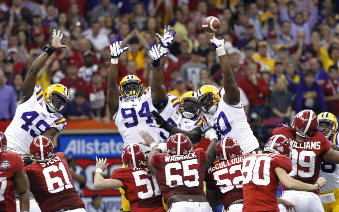 FILE - In this Jan. 9, 2012, file photo, Alabama's Jeremy Shelley (90) has a field goal blocked during the first half of the BCS National Championship college football game against LSU, in New Orleans. (AP Photo/Gerald Herbert, File)