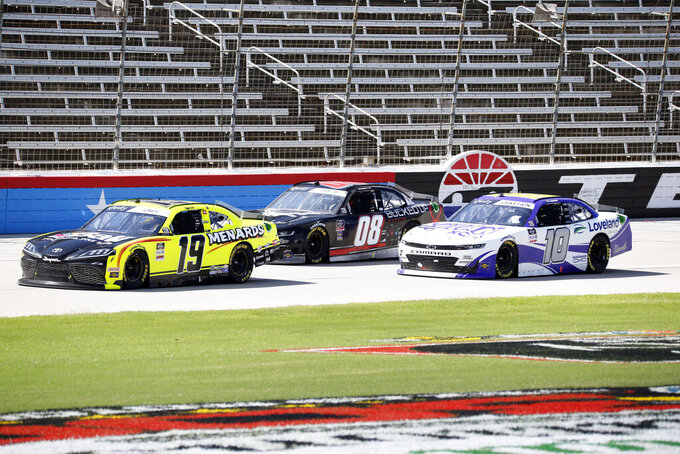Brandon Jones (19), Joe Graf Jr. (08) and Ross Chastain (10) drive down the front stretch during a NASCAR Xfinity Series auto race at Texas Motor Speedway in Fort Worth, Texas, Saturday, July 18, 2020. (AP Photo/Ray Carlin)