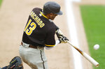 San Diego Padres' Manny Machado hits an RBI single off Colorado Rockies relief pitcher Carlos Estevez during the eighth inning of a baseball game Sunday, Aug. 2, 2020, in Denver. The Rockies won 9-6. (AP Photo/David Zalubowski)