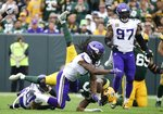 Minnesota Vikings' Anthony Harris stops Green Bay Packers' Aaron Jones after a first down run during the second half of an NFL football game Sunday, Sept. 15, 2019, in Green Bay, Wis. The Packers won 21-16. (AP Photo/Mike Roemer)