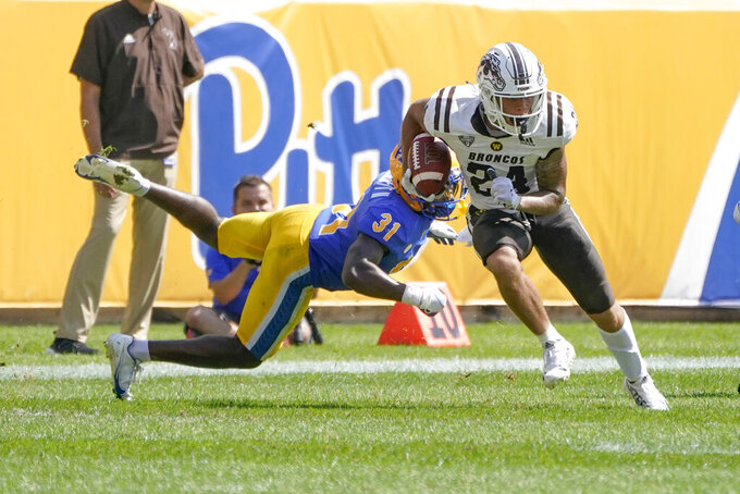 Pittsburgh defensive back Erick Hallett (31) dives after Western Michigan wide receiver Skyy Moore (24) after he made a catch during the first half of an NCAA college football game, Saturday, Sept. 18, 2021, in Pittsburgh. (AP Photo/Keith Srakocic)