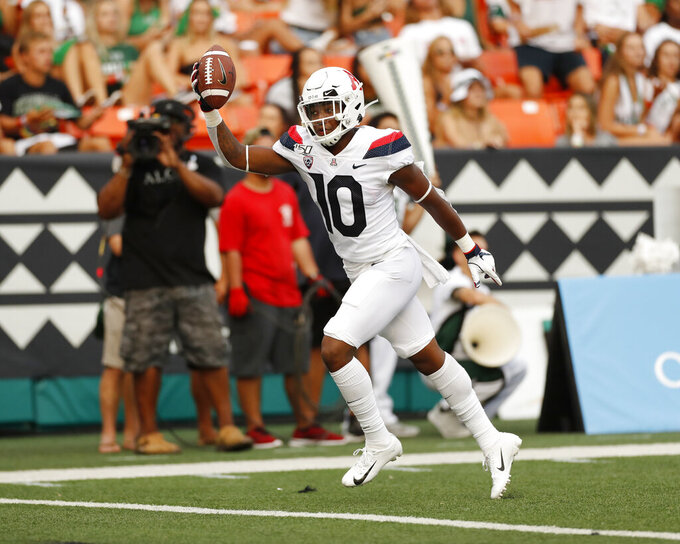 Arizona wide receiver Jamarye Joiner (10) runs in for a touchdown against Hawaii during the second quarter of an NCAA college football game Saturday, Aug. 24, 2019, in Honolulu. (AP Photo/Marco Garcia)