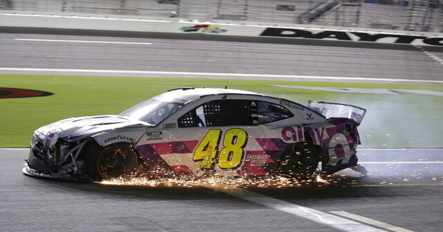Jimmie Johnson drives his damaged car on pit road during the NASCAR Cup Series auto race at Daytona International Speedway, Saturday, Aug. 29, 2020, in Daytona Beach, Fla. (AP Photo/Terry Renna)