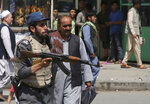 An Afghan policeman stands guard after an explosion near the police headquarters in Kabul, Afghanistan, Wednesday, Aug. 7, 2019. A suicide car bomber targeted the police headquarters in a minority Shiite neighborhood in western Kabul on Wednesday, setting off a huge explosion that wounded dozens of people, Afghan officials said. The Taliban claimed responsibility for the bombing. (AP Photo/Rafiq Maqbool)