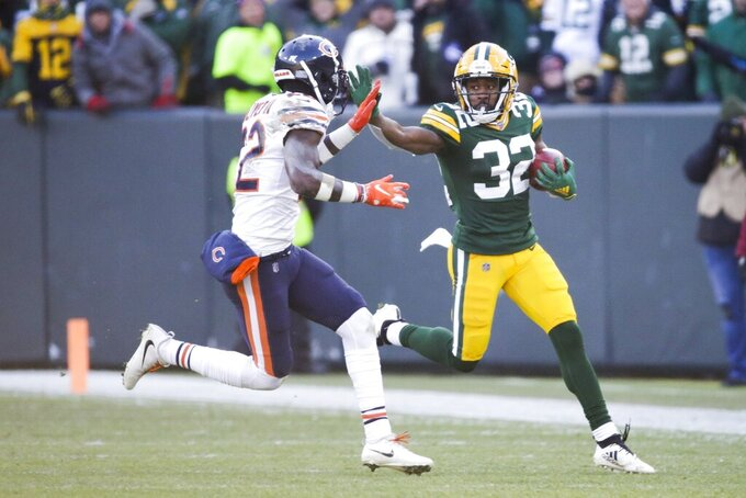 Green Bay Packers' Tyler Ervin runs after a catch during the first half of an NFL football game against the Chicago Bears Sunday, Dec. 15, 2019, in Green Bay, Wis. (AP Photo/Mike Roemer)