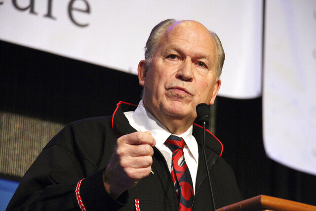 FILE - In this Oct. 18, 2018, file photo, then-Alaska Gov. Bill Walker addresses delegates at the annual Alaska Federation of Natives conference in Anchorage, Alaska. Former Alaska Gov. Walker, who was one of the country's few politically unaffiliated governors, plans to discuss with students bridging the political divide during an upcoming, on-campus residency at Harvard University. (AP Photo/Mark Thiessen, File)
