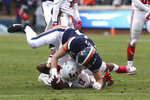 Virginia's Tanner Cowley (44) tackles Liberty's Brandon Tillmon (12)  during an NCAA college football game Saturday, Nov. 23, 2019, in Charlottesville, Va. (Erin Edgerton/The Daily Progress via AP)