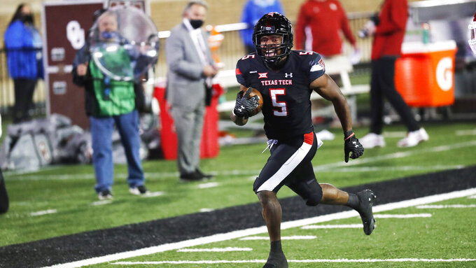 Texas Tech running back Chadarius Townsend scores a touchdown during the second half of the team's NCAA college football game against Oklahoma on Saturday, Oct. 31, 2020, in Lubbock, Texas. T(AP Photo/Mark Rogers)