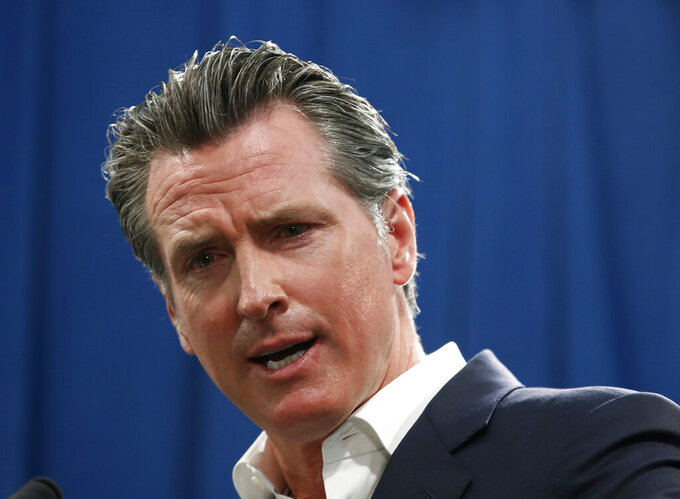 FILE - In this Sept. 16, 2019, file photo, Gov. Gavin Newsom answers a question during a news conference in Sacramento, Calif. Newsom announced Monday, Sept. 30, he signed a law that would let athletes at California universities make money from their images, names or likenesses. The law also bans schools from kicking athletes off the team if they get paid. (AP Photo/Rich Pedroncelli, File)