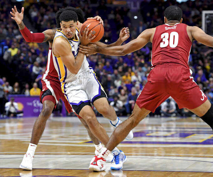 LSU guard Skylar Mays (4) drives to the basket as Alabama guard John Petty Jr., left, and Alabama forward Galin Smith (30) defend in the first half of an NCAA college basketball game, Wednesday, Jan. 29, 2020, in Baton Rouge, La. (AP Photo/Bill Feig)